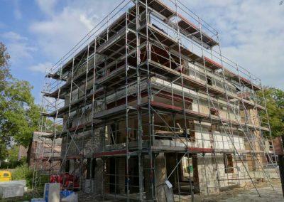Sanierung und Rohbau für ein Mehrfamilienhaus